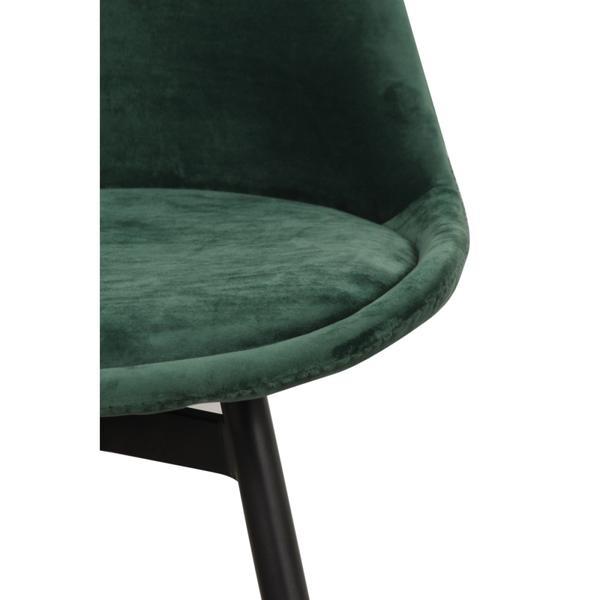 groene stoffen stoel met ijzeren poten zijkant